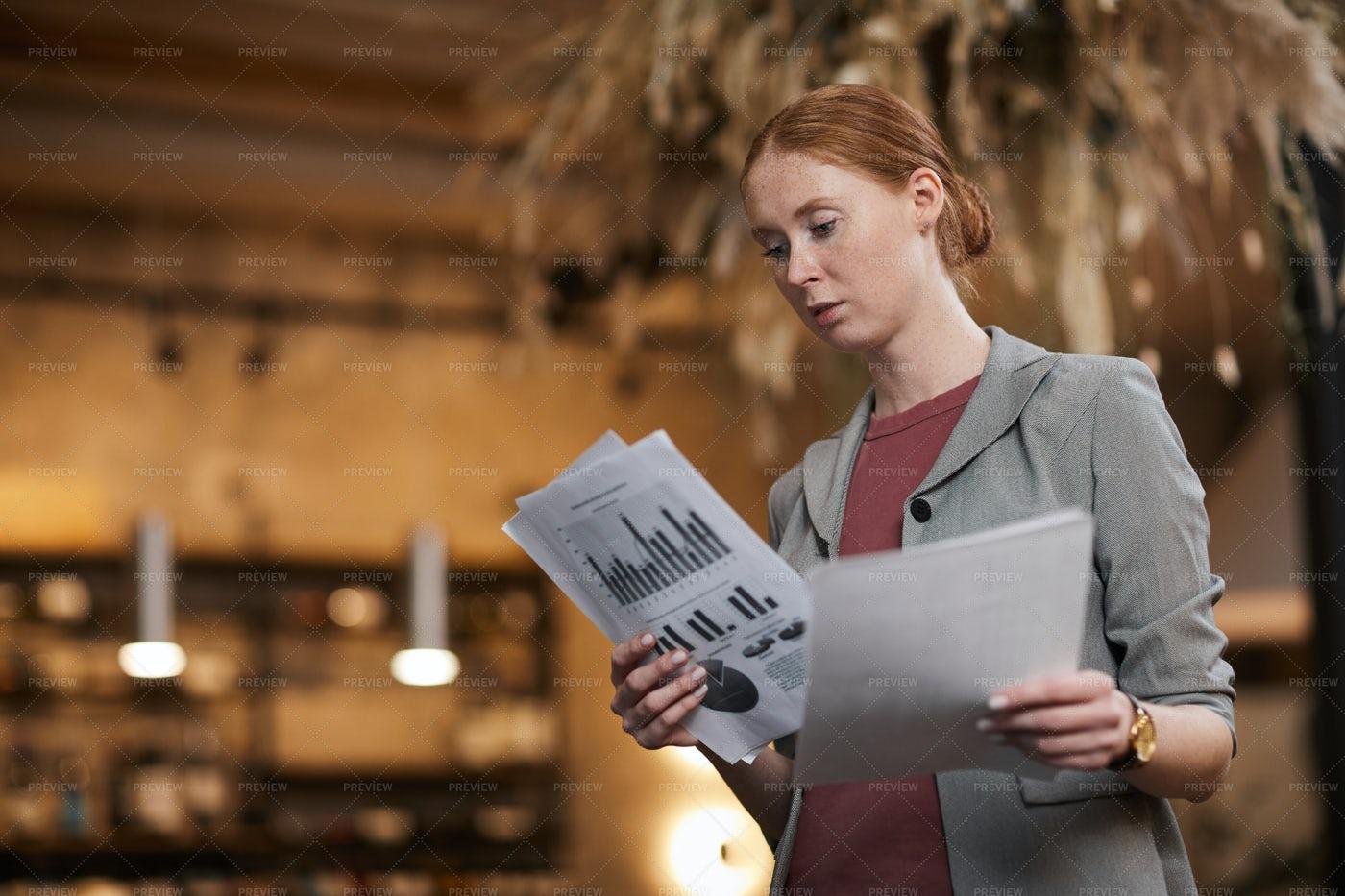 Businesswoman Reading Financial Chart: Stock Photos