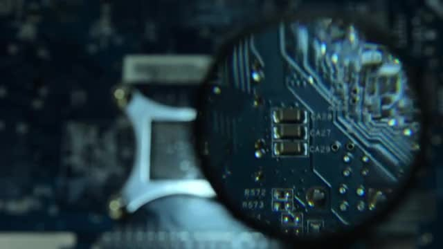 Circuit Board Through a Magnifying Glass: Stock Video