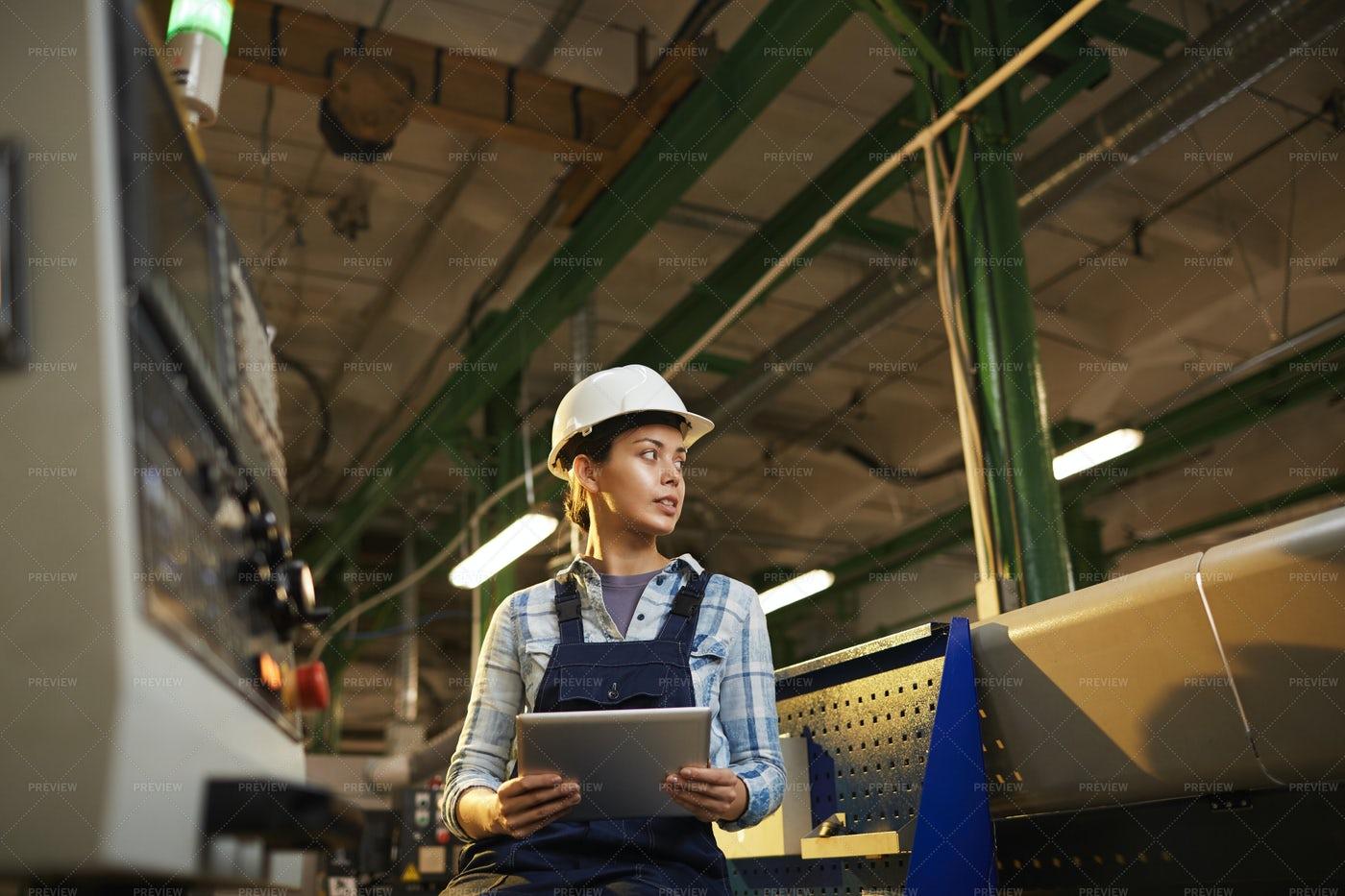 Technician Controls The Machine: Stock Photos