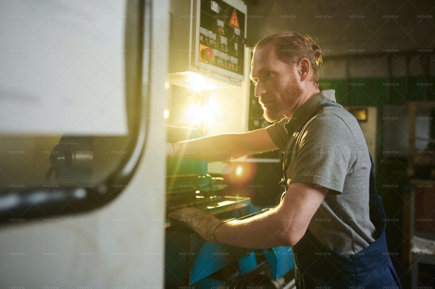 Technician Operating The Lathe: Stock Photos