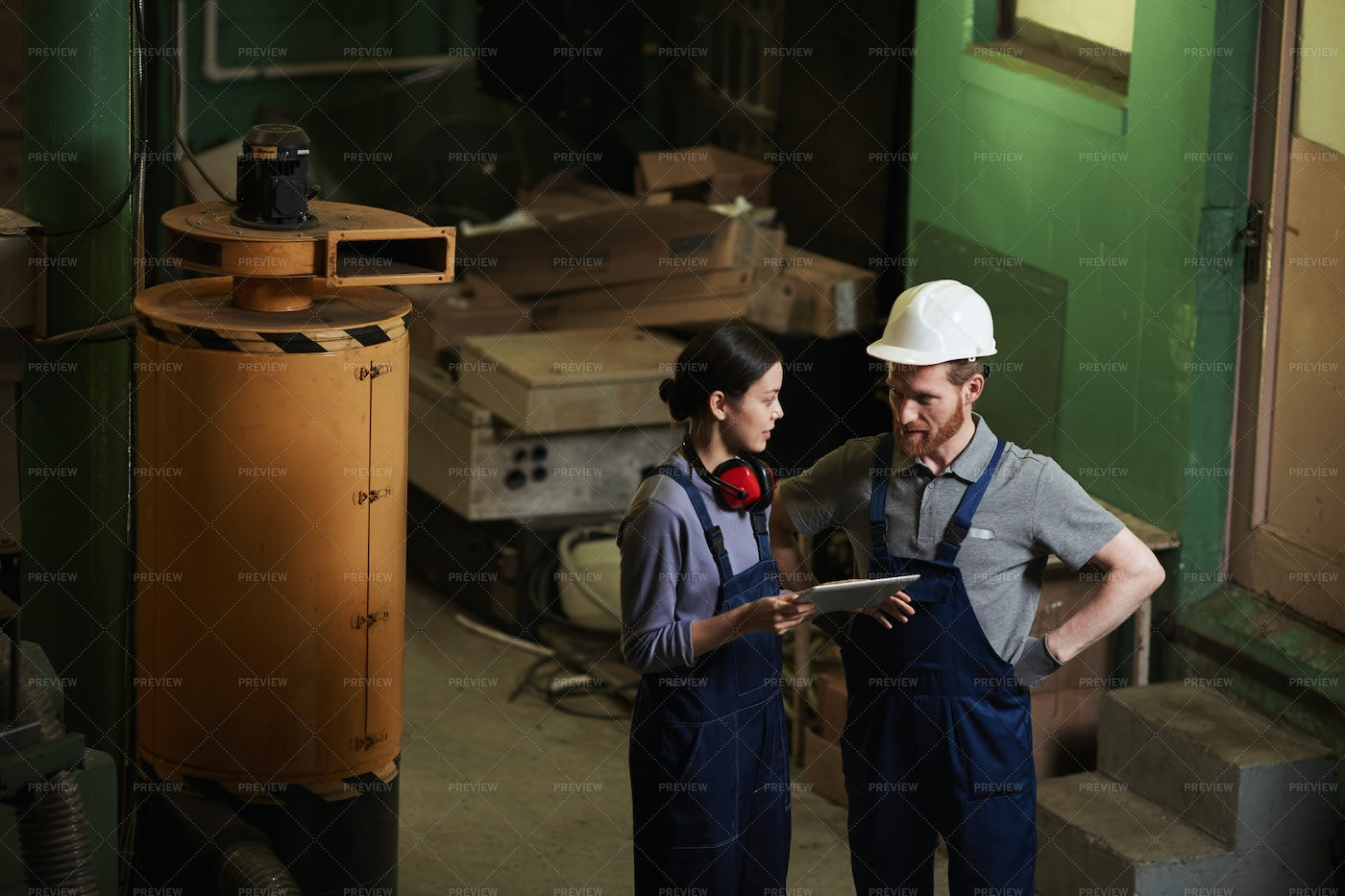 Manual Workers Using A Digital Tablet: Stock Photos