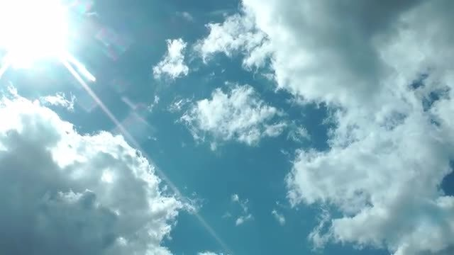 Bright Rain Clouds Moving With Lens Flare: Stock Video