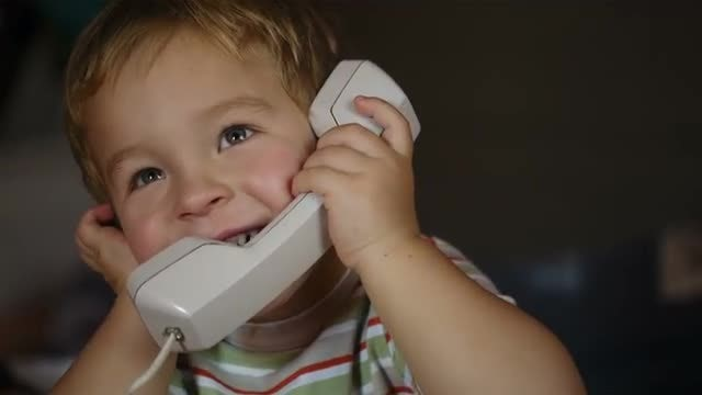 Excited Boy On The Telephone : Stock Video