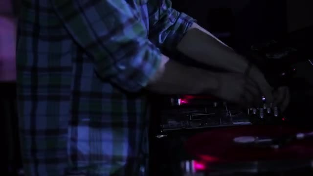 DJ On Decks In Nightclub: Stock Video