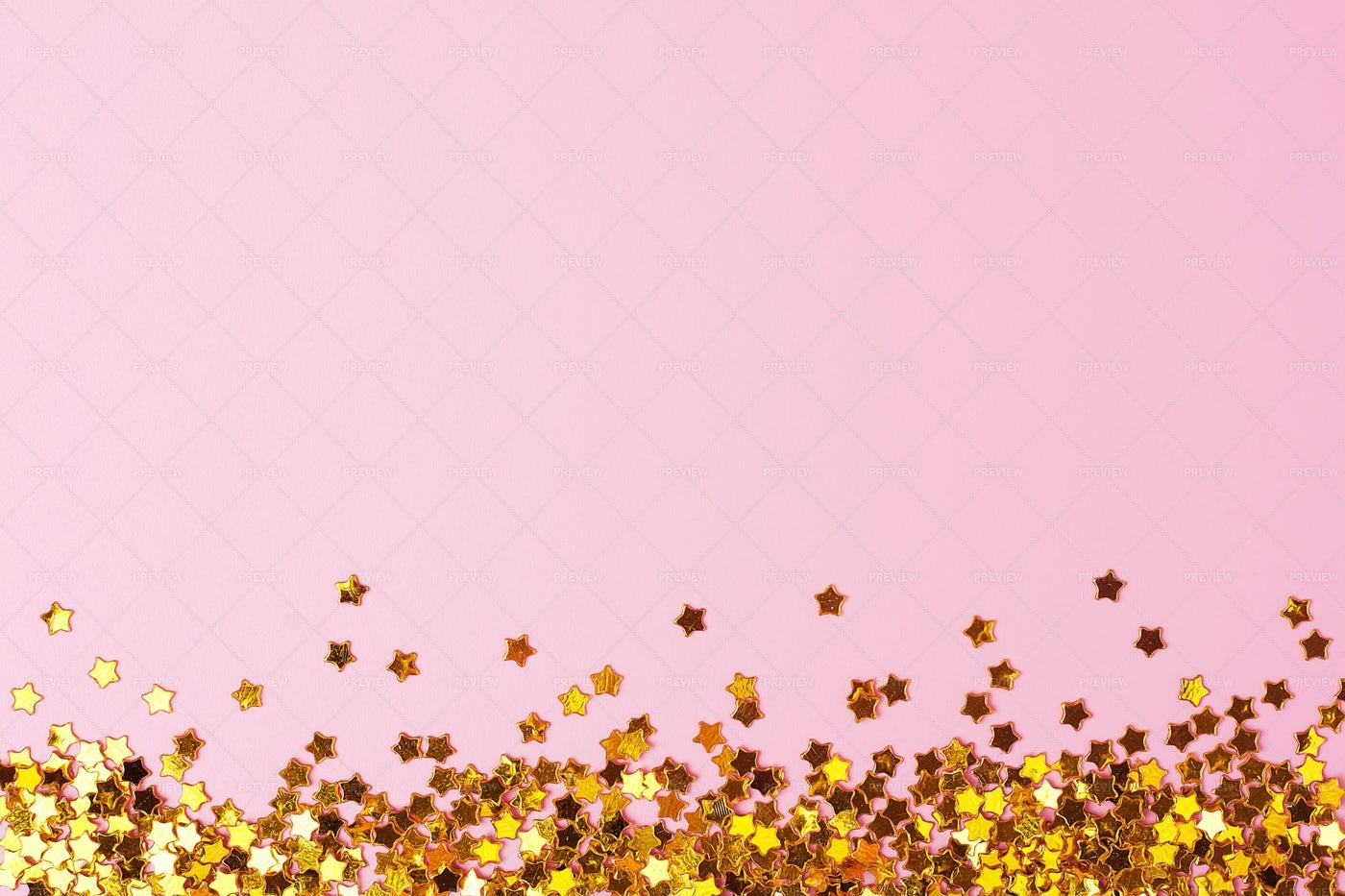 Golden Confetti On Pink: Stock Photos