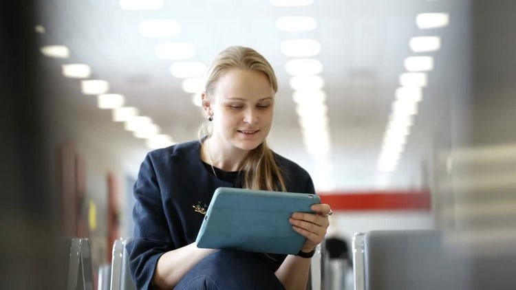 Woman Using A Digital Tablet : Stock Video