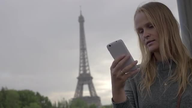 Woman Taking Shot Of Eiffel Tower: Stock Video