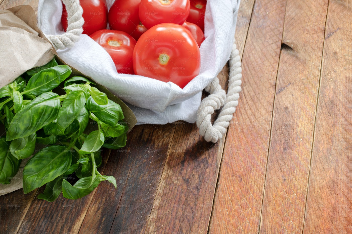 Tomatoes And Basil In An Eco Bag: Stock Photos