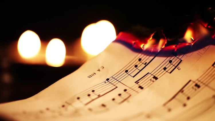 Sheets Of Music Notes Burning: Stock Video