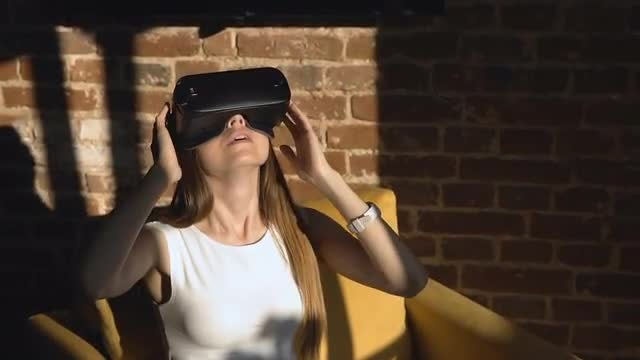 Woman Tries Virtual Reality Glasses: Stock Video