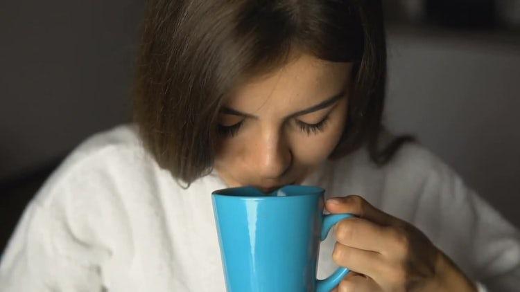 Beautiful Girl Enjoys Coffee Time: Stock Video
