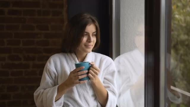 Drinking Coffee By The Window: Stock Video