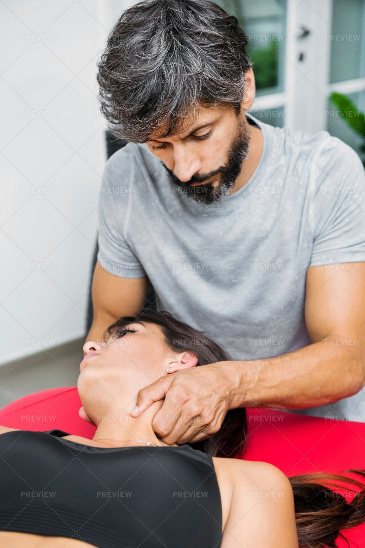 Osteopath Performing Massage: Stock Photos