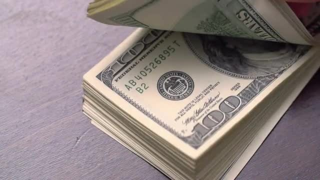 Bundle of American Dollars On A Table: Stock Video