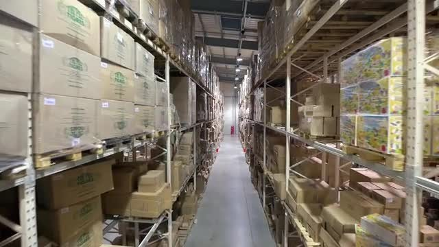 Gliding Through A Warehouse Lane: Stock Video