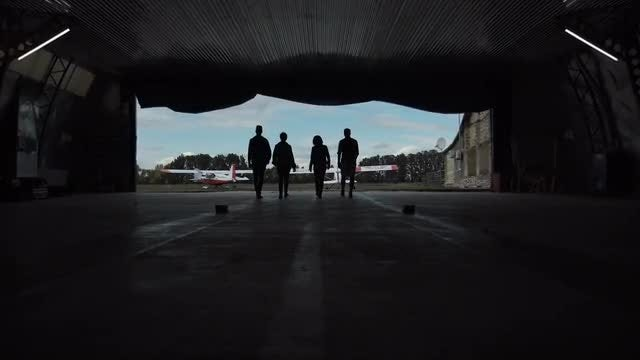 People Walking Through The Hangar: Stock Video