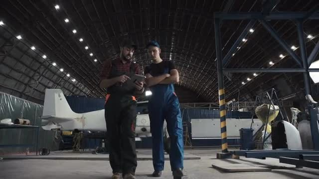 Aeronautical Engineers In A Hangar: Stock Video
