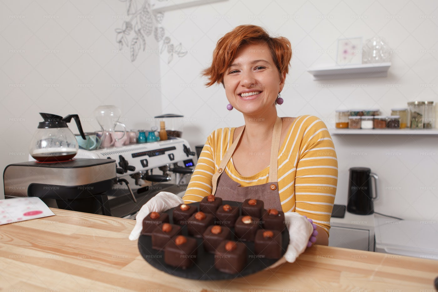 Cheerful Woman Selling Cakes: Stock Photos