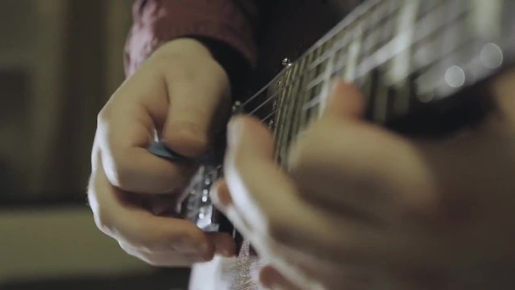 Man Playing The Electric Guitar: Stock Video
