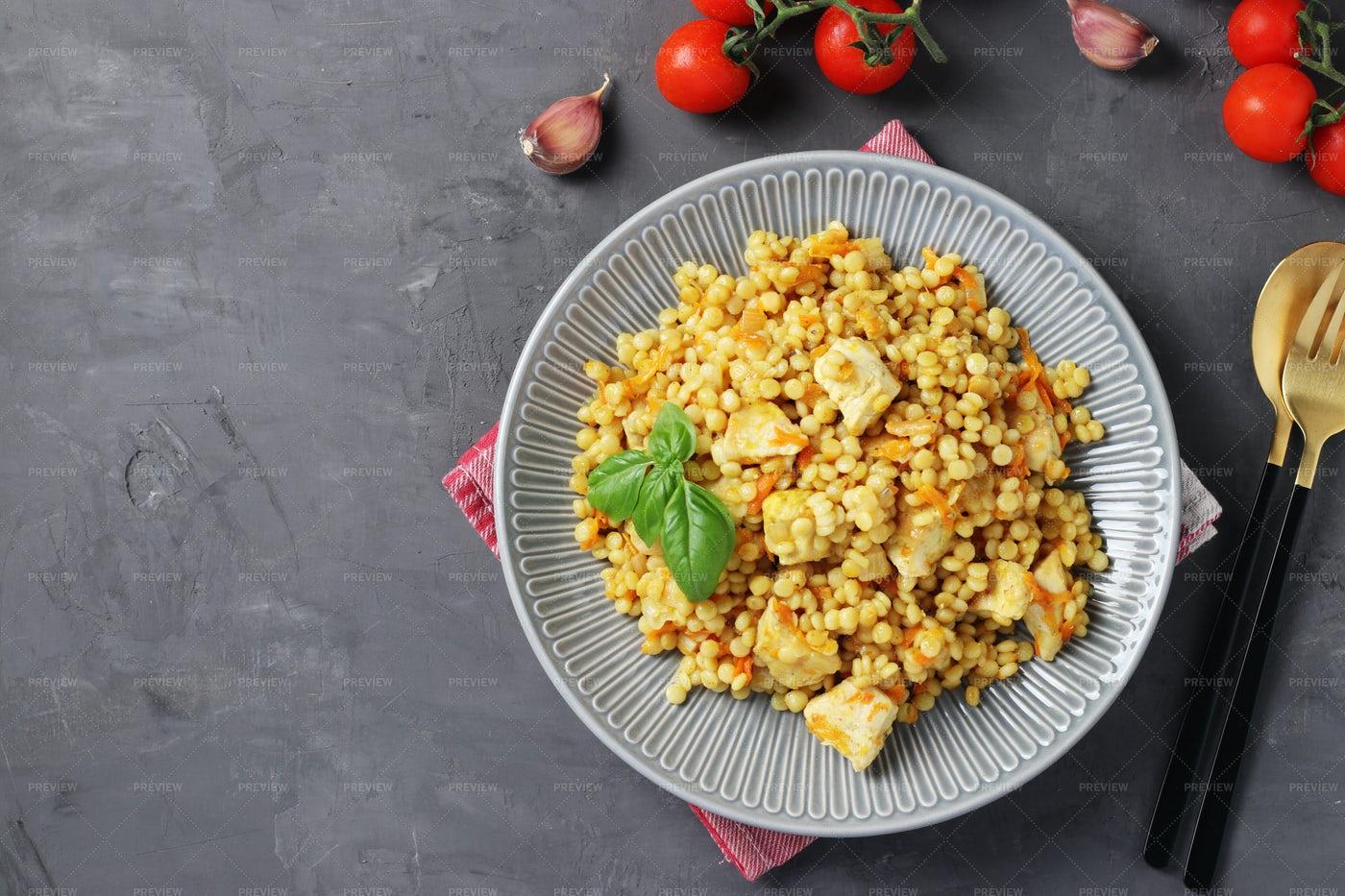 Ptitim Pasta With Chicken: Stock Photos