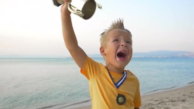 Young Boy Lifting The Trophy: Stock Video