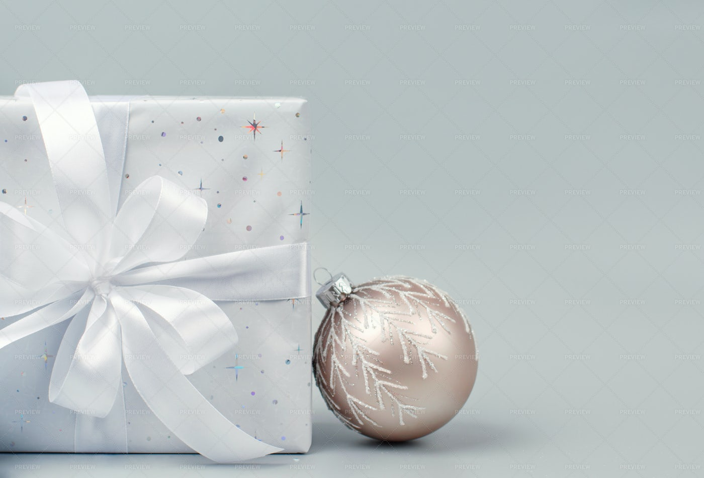 Christmas Present And Bauble: Stock Photos