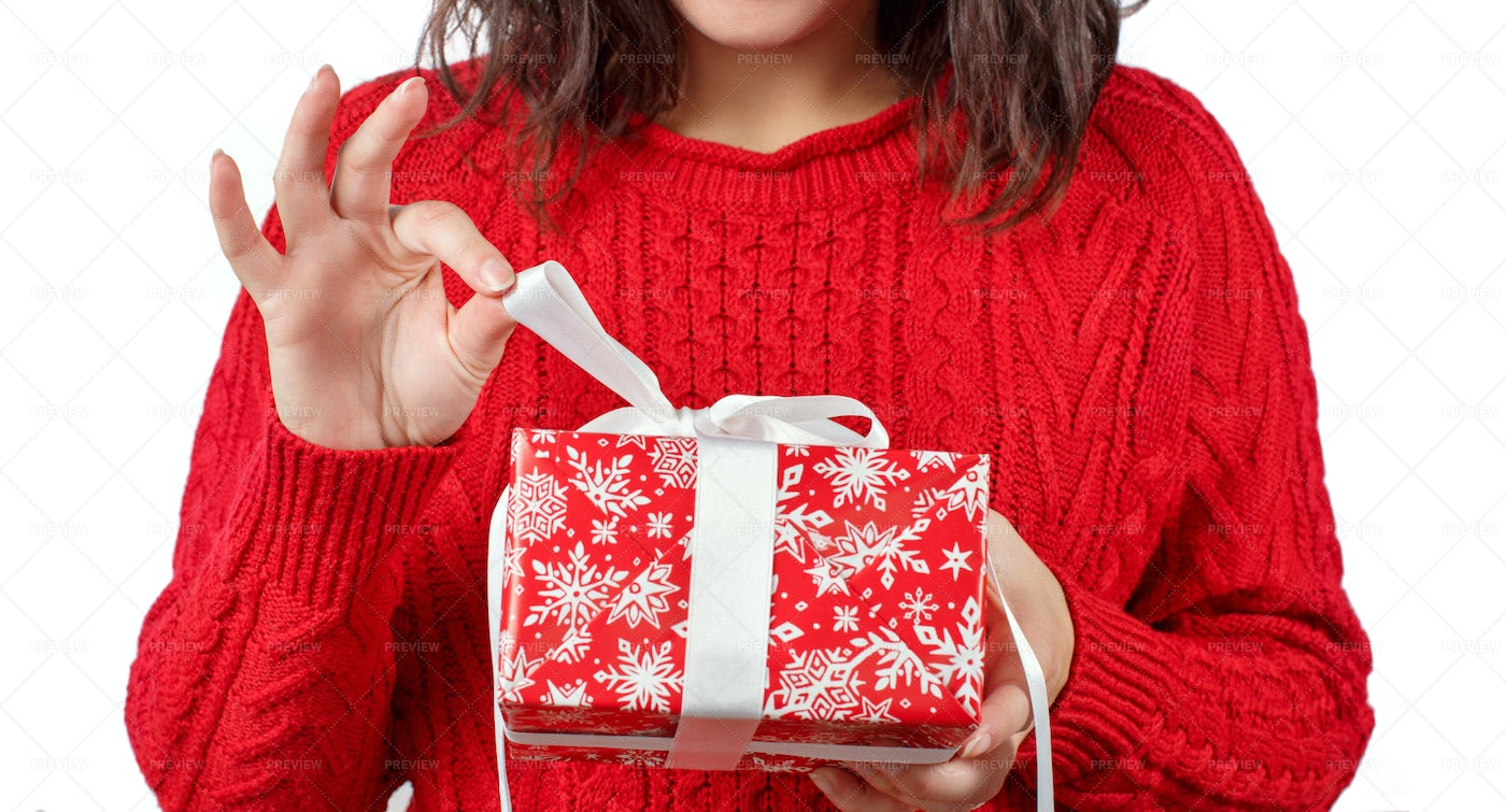 Woman Holding Wrapped Gift: Stock Photos