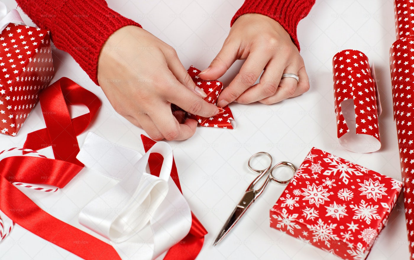 Woman Wrapping Present: Stock Photos