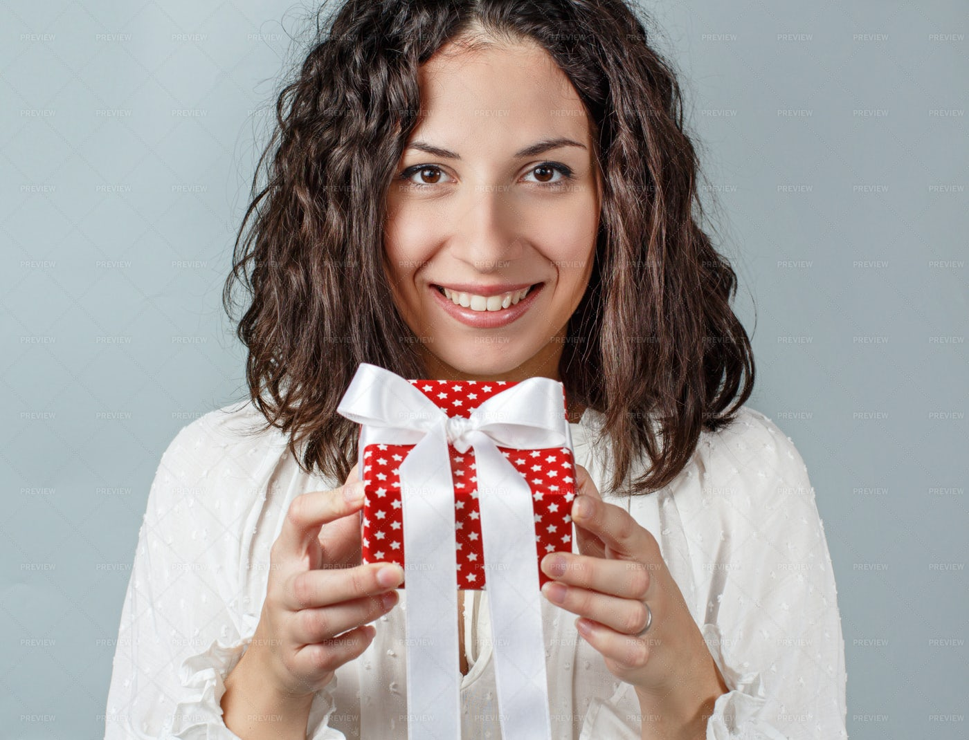 Young Woman Holding Present: Stock Photos