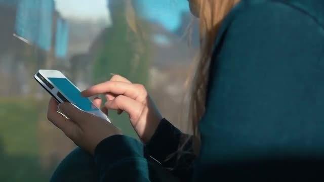 Woman Using Smartphone On Train: Stock Video