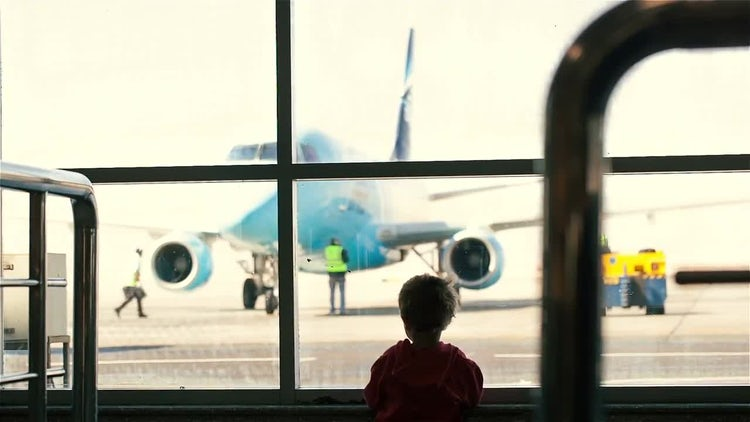 Young Boy At The Airport: Stock Video