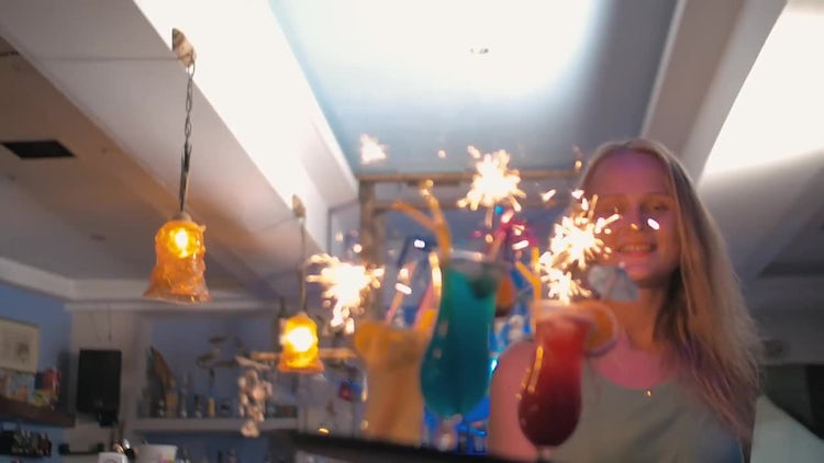 Waitress Carrying Cocktails With Sparklers: Stock Video