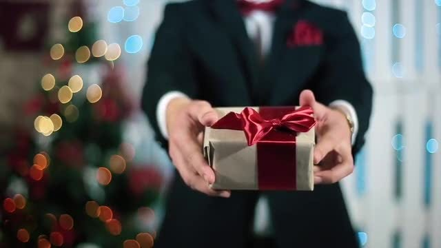 Giving A Christmas Gift : Stock Video