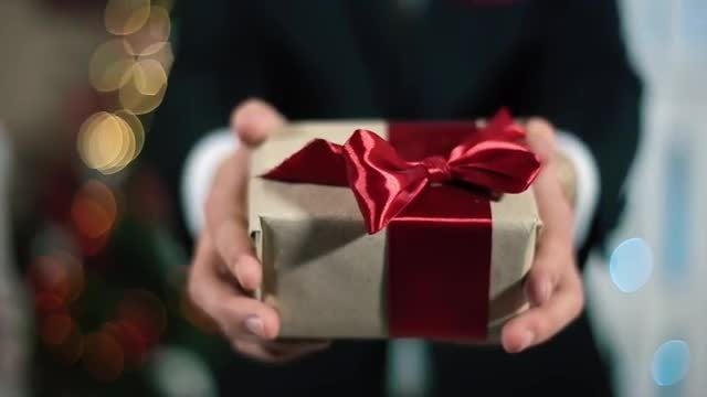 Man In Suit Gives Gift : Stock Video