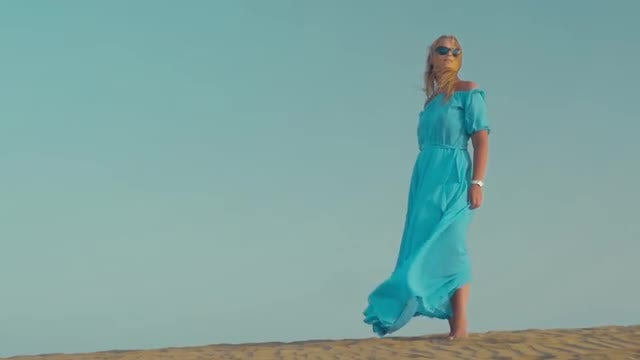 Woman In Blue Dress Outdoors : Stock Video