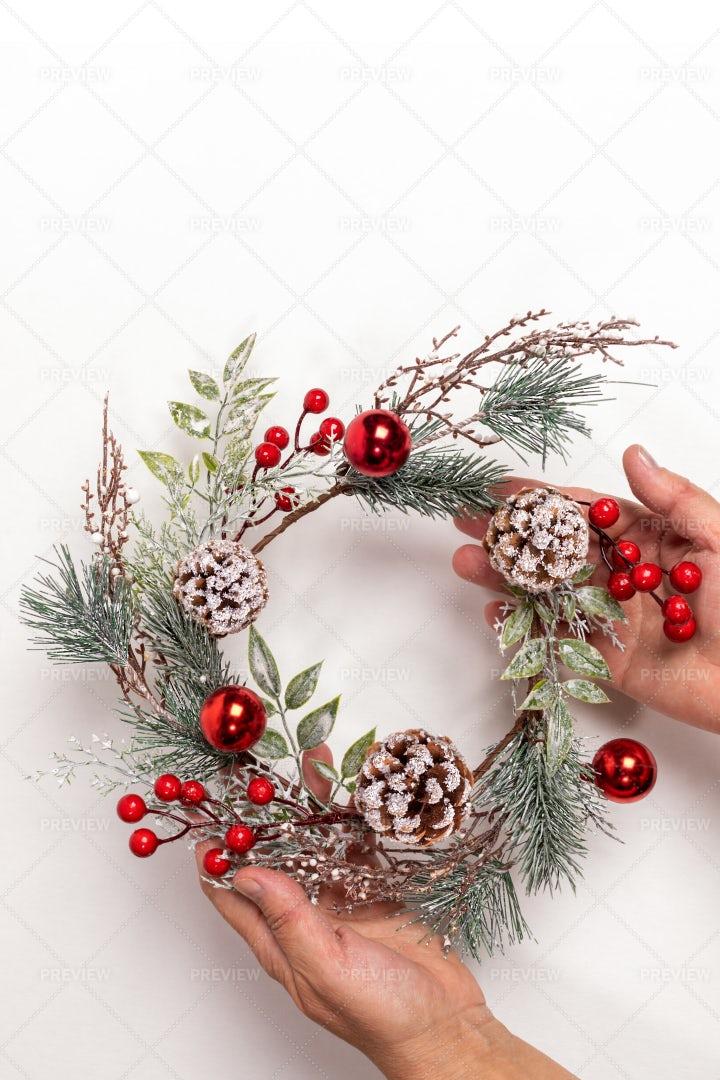 Hands Holding Christmas Wreath: Stock Photos