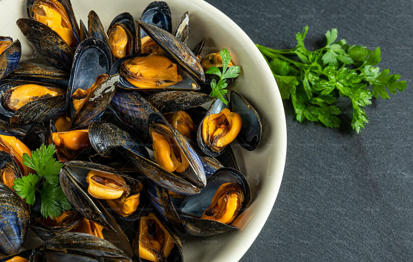 Cooked Mussels And Parsley: Stock Photos