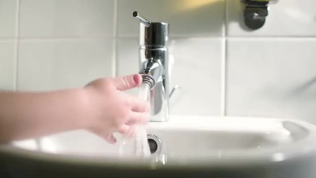 Child Playing With Tap Water: Stock Video