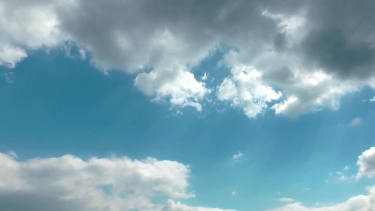 Cumulus Clouds Under Clear Sky: Stock Video