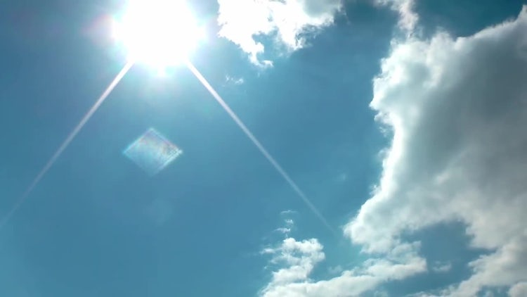 White Clouds Under Bright Sun : Stock Video