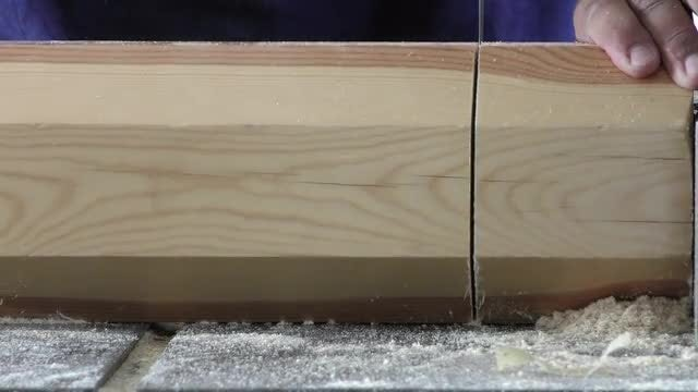 Carpenter Cutting Piece Of Wood: Stock Video