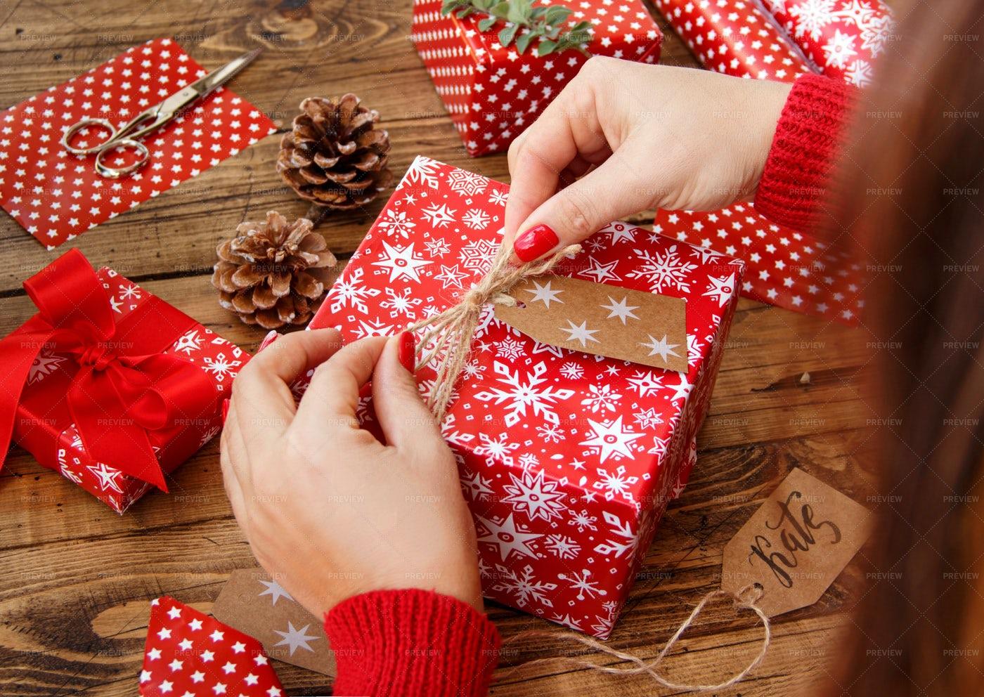 Woman Wrapping A Christmas Present: Stock Photos