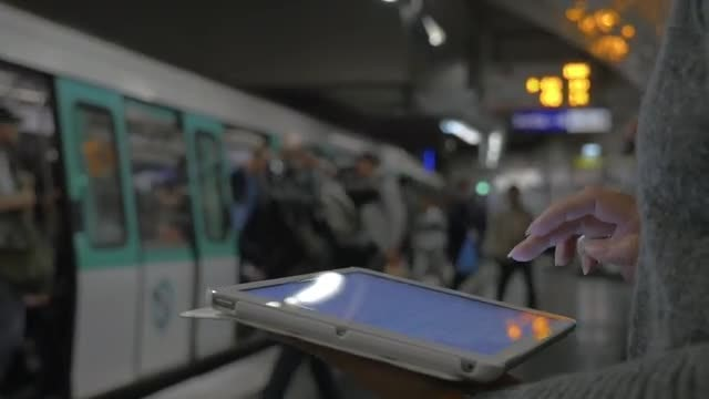 Using Tablet Before Train Ride: Stock Video