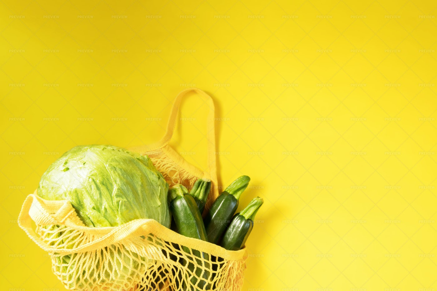 Mesh Bag And Green Vegetables Background: Stock Photos