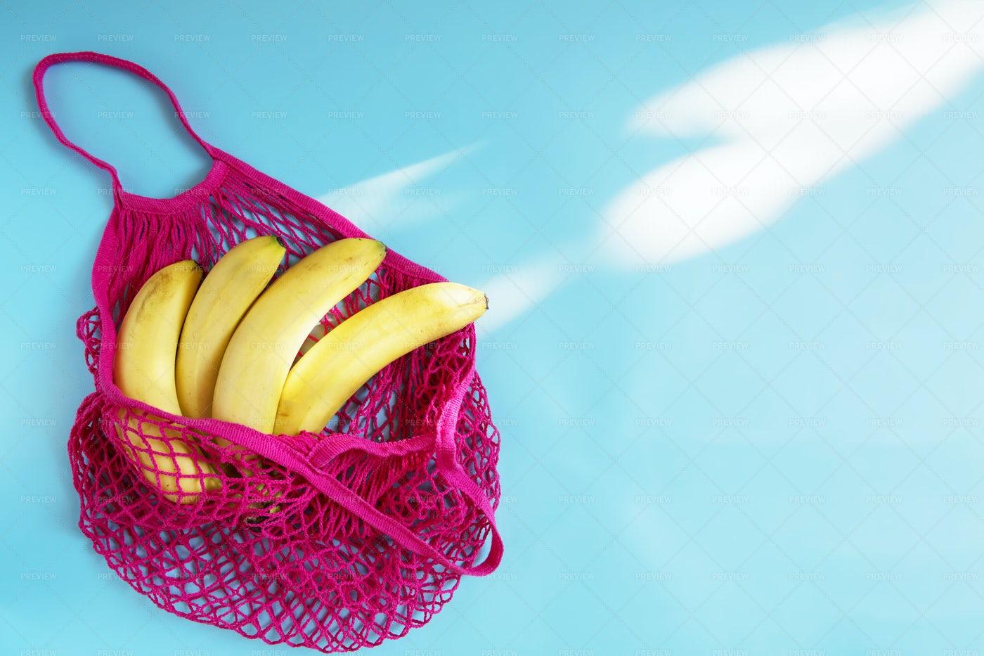 Banana In Mesh Bag: Stock Photos