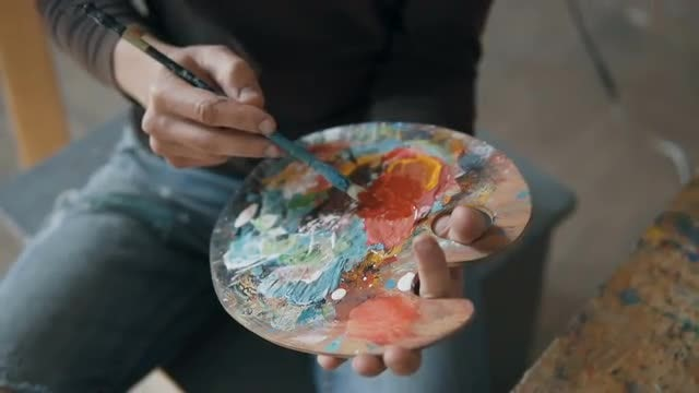 Male Artist Preparing Painting Palette: Stock Video