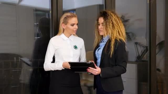 Female Employees Talking In Office: Stock Video