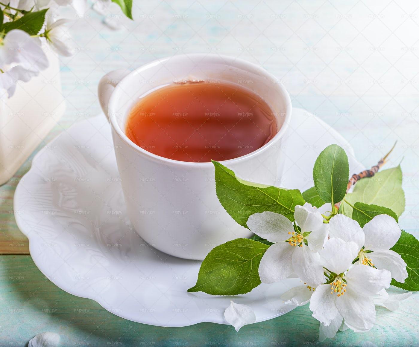 Tea And Apple Flowers: Stock Photos