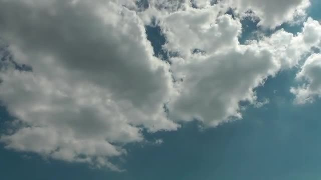 White Clouds Beneath Blue Sky: Stock Video