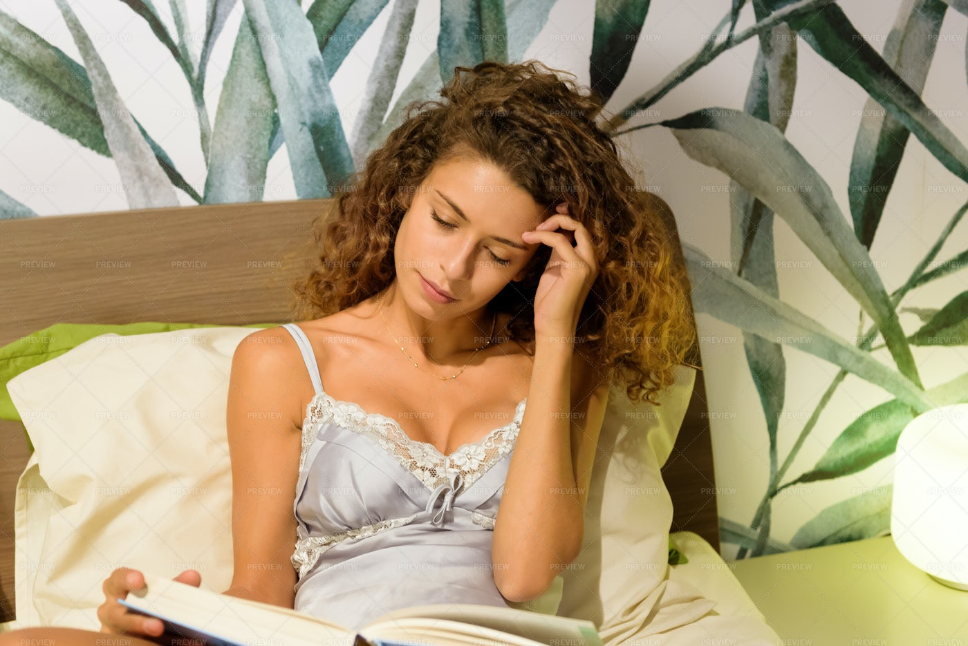Woman Relaxing On Her Bed: Stock Photos